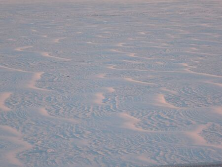 Snow surface created by a wind on the frozen river