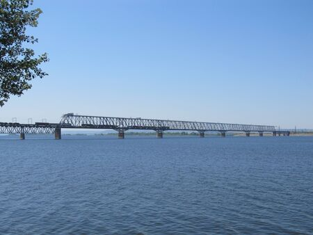 Railway bridge over the river. Sunny spring day.