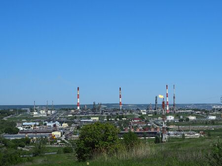 Oil refinery and petrochemical architecture plant industrial with blue sky background, White oil and gas refinery tank, Oil refinery plant from industry zone business power and energy petroleum