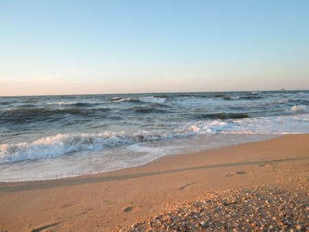 Beautiful seashell beach at sunset by the sea. 版權商用圖片