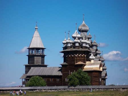 Kizhi, Russia - June , 2005: Tourists at Kizhi Pogost with Transfiguration Church on Ladoga Lake in Karelia, Russia