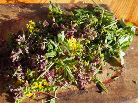 plants is cut on a wooden vintage Board for making natural herbal tea