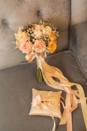 Beautiful bridal bouquet and rings on a cushion