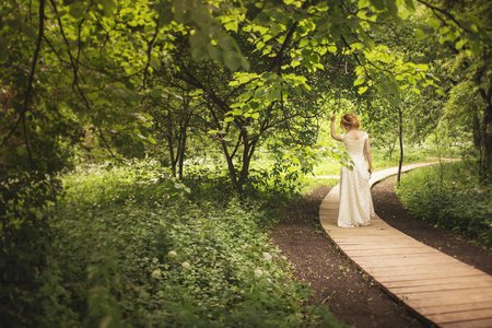 marriageable: Bride in the park Stock Photo