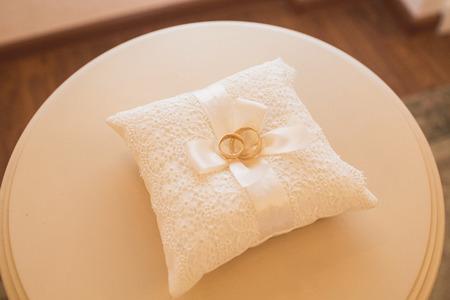 white pillow: wedding rings on a cushion Stock Photo