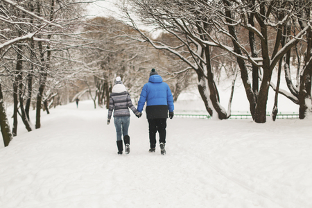 photo story: winter photo shoot in the style love story, Couple walks in the park