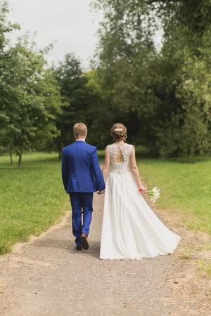 walk in: Wedding newlyweds walk in park