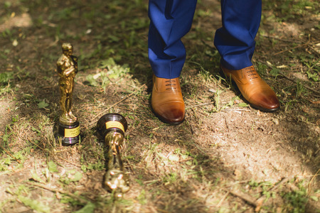 oscar: bride brown boots and Oscar statuette