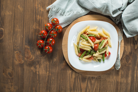 pasta salad: Pasta salad with  tomatoes on the kitchen table, top view Stock Photo