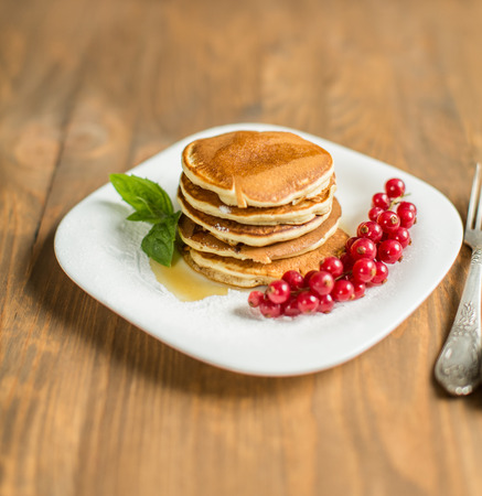 brambleberry: Pancakes with berries and maple syrup Stock Photo