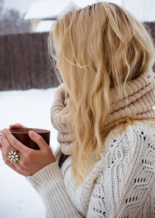 checkered scarf: Girl drinks hot tea in winter Stock Photo