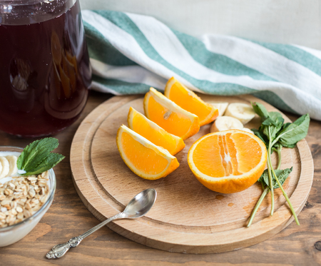 wholesome: Healthy and wholesome breakfast. Sliced %u200B%u200Boranges on wooden board Stock Photo