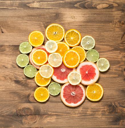 half  cut: Fresh citrus fruits half cut on wooden background