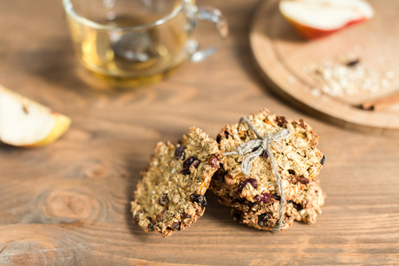 useful: Useful oatmeal cookies with raisins and cranberries Stock Photo