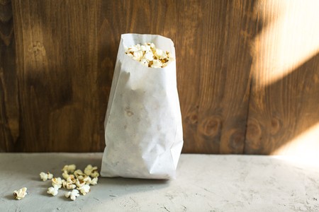 holiday movies: salted popcorn in paper bag