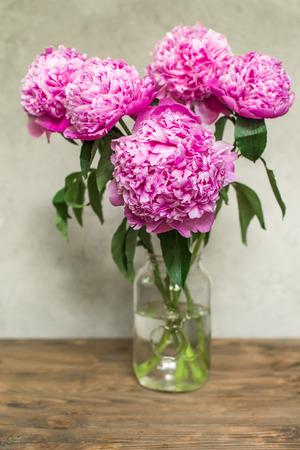 lush: lush pink peonies in vase