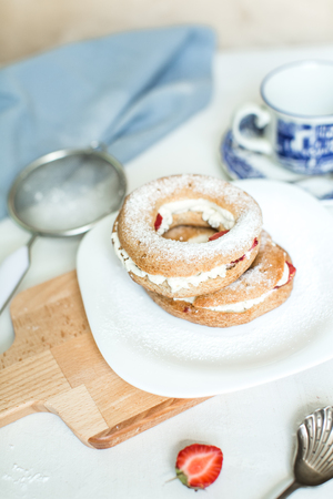 profiterole: home baking: cottage cheese with strawberry ring Stock Photo