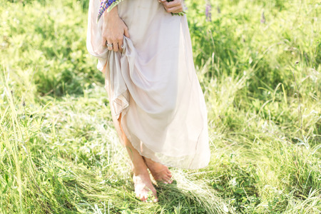 lupins: beautiful young woman in dress with beautiful lupins Stock Photo