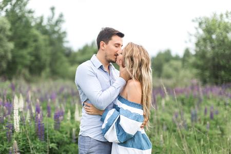 loving couple embracing and kissing each other in nature