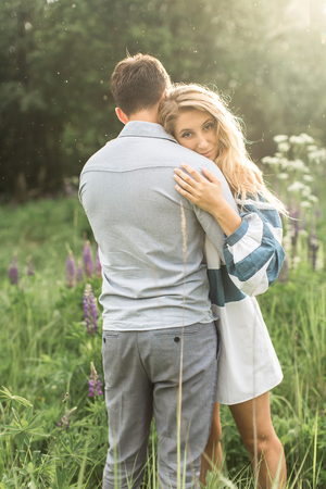 arm bouquet: loving couple embracing each other in nature