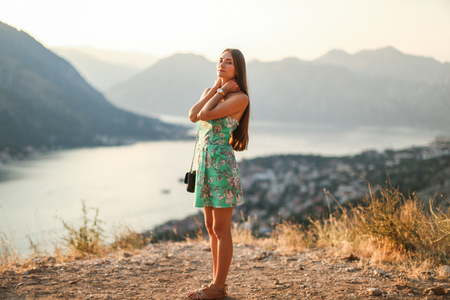 kotor: happy woman at sunset in the sun Stock Photo