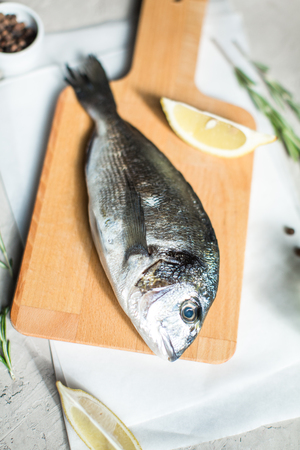 Fresh dorado fish with herbs and pepper Stock Photo