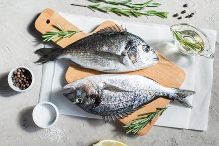 dorado fish: Fresh dorado fish with herbs and pepper Stock Photo