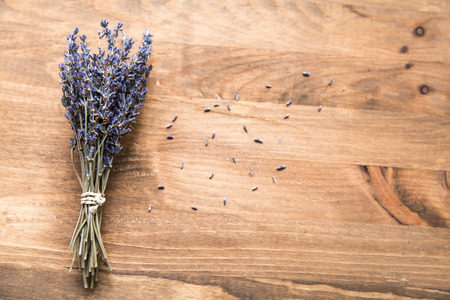 stalk: bouquet of lavender on wooden background