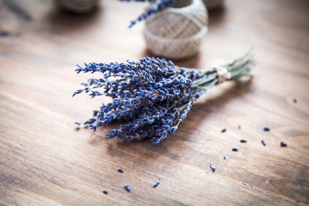 brawn: bunch of lavender and spools of thread on wooden background Stock Photo