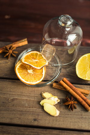 assortment of spices: cinnamon, orange, ginger and anise Stock Photo
