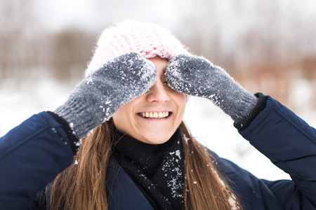 happy girl mittens winter closes his eyes Stock Photo