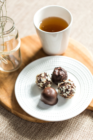 Useful sweets with coconut in chocolate