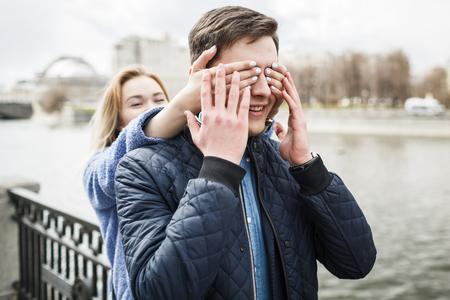Girl closes her boyfriends eyes