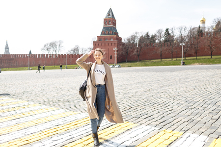 young woman is walking in the city of Moscow on the Red Square