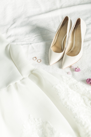 Wedding clothes of the bride: dress, shoes and rings