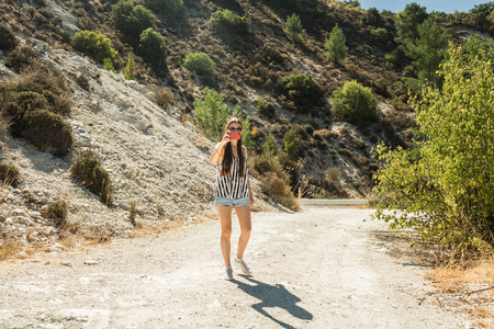 girl high in the mountains of island Cyprus Stock Photo