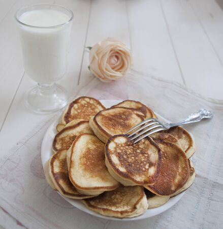 cheese cakes for breakfast with milk and rose flower