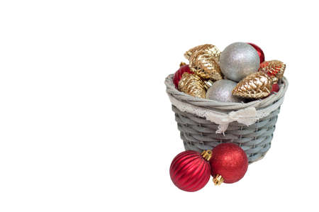 Christmas decorations in a basket on a white background