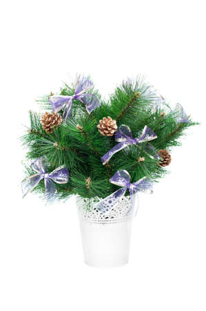 Artificial Christmas tree in a white bucket on a white background