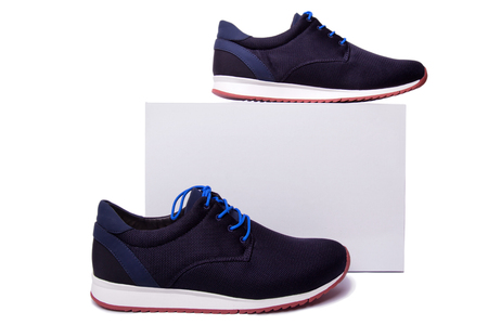 black and blue mens sport shoes near the white box. Isolate on white.