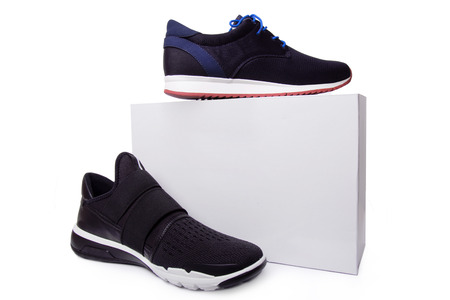 shoelace: mens black sport shoes near the white box. Isolate on white.