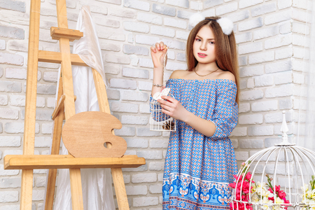 beautiful little girl with perfect makeup and hair-dress in iInterior studio