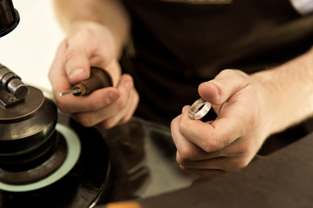 diamond ring: The process of creating and polishing the ring close-up. Handmade. Work in the workshop with tools Stock Photo
