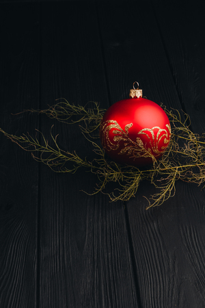 Christmas New Year decoration composition. Top view of fur-tree branches and balls frame on wooden background with place for your text.