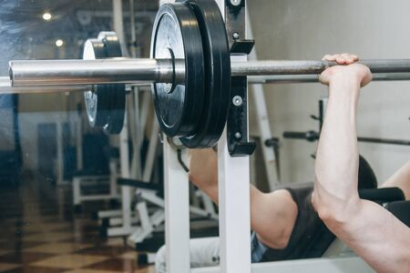 athlete shakes pectoral muscles in the center of training. exercise chest press. training tools in the gym close-up.