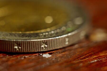 Edge Euro Coin Macro Isolated On Black Background. Detail of metallic money close up. EU money.