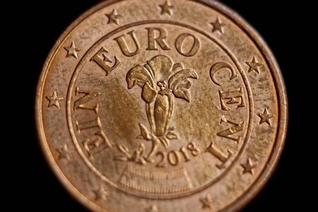 Reverse side of the coin one euro cent macro isolated on black background. Detail of metallic money close up. EU money. Stock Photo