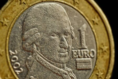 one euro coin close up isolated on black background. Detail of metallic money close up. EU money. Stock Photo