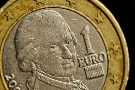 one euro coin close up isolated on black background. Detail of metallic money close up. EU money. 免版税图像