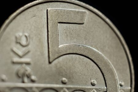 Five Czech koruna coin close-up isolated on black background. Detail of metallic money close up. European country money Czech Republic. Stock Photo